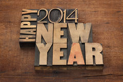 Happy New Year 2014. Greetings - text in vintage letterpress wood type blocks on a grunge wooden background Royalty Free Stock Photo