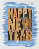 Happy New Year. Greetings or wishes - a collage of  text in vintage letterpress wood type blocks and watercolor painting on canvas Royalty Free Stock Images