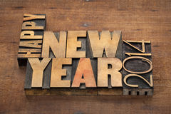 Happy New Year 2014. Greetings or wishes - text in vintage letterpress wood type blocks on a grunge wooden background Royalty Free Stock Photo
