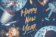 Happy new year hand brush stroke font on marble table with party stock image
