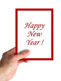 Happy new year. Hand hold a big card with text Happy new year. isolated on white stock images