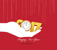 Happy new year 2017 hand holding a clock.  Royalty Free Stock Photography