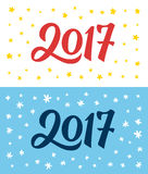 Happy New Year 2017 hand lettering numbers on card. Calligraphic numbers 2017 on greeting cards templates with doodle stars and snowflakes. Vintage flat style royalty free illustration