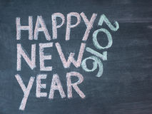 Happy new year 2016. Hand writing with chalk on blackboard, vintage concept Royalty Free Stock Photos