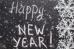 Happy new year 2017, hand writing with chalk on blackboard Royalty Free Stock Image