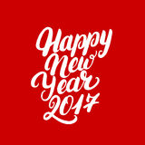 Happy New Year 2017 hand written lettering. Modern brush calligraphy. Christmas greeting card on red background. Vector illustration Royalty Free Stock Photography