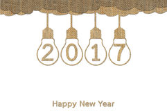 Happy New Year 2017. Hanging lightbulb on sky design from sackcloth stock illustration