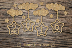 Happy New Year 2016. Hanging star and cloud on wood background Stock Photography