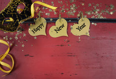 Happy New Year haning hearts on red distressed wood Royalty Free Stock Images