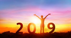 Happy New Year 2019 - Happy Girl With Numbers. At Sunrise royalty free stock photo