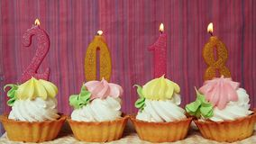 Happy new 2018 year. With candles on cakes with pink background stock video footage