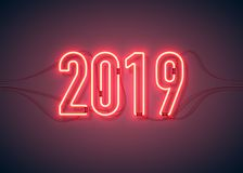 Happy new year 03. Happy New Year with neon sign 2019 on dark background. Christmas related ornaments objects on color background. Greeting Card Ready for your royalty free illustration