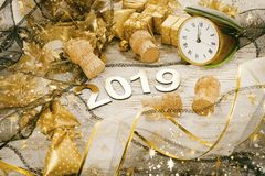 Happy New Year 2019. Symbol from number 2019 on wooden background royalty free stock photo