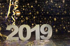 Happy New Year 2019. Symbol from number 2019 on wooden background stock photo