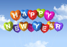 Happy new year heart shaped balloons Stock Images
