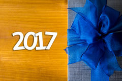 2017 Happy New Year Holiday on blur bokeh and box background wit Stock Photos