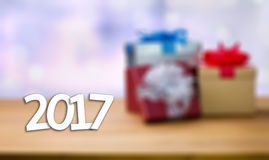 2017 Happy New Year Holiday on blur bokeh and box background wit Stock Photography