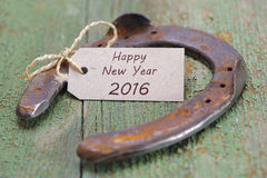 Happy new year 2016 with horse shoe. Happy new year 2016 with horseshoe as lucky charm for success Stock Image