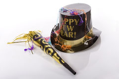 Happy New Year II. Top hat that says happy new year and other party favors isolated against white background Royalty Free Stock Photos
