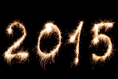 Happy New Year 2015- inscription made sparklers. Royalty Free Stock Images