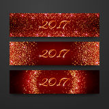 Happy New Year 2017 invitation design collection. Headline holiday template with sparkles on red background. Gold glitter banner s Royalty Free Stock Photo