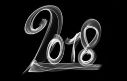 Happy new year 2018 isolated numbers lettering written with fire flame or smoke on black background.  Stock Photo