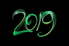 Happy new year 2019 isolated numbers lettering written with fire flame or smoke on black background.  vector illustration