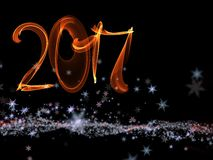 Happy new year 2017 isolated numbers lettering written with fire flame or smoke on black background.  Stock Images