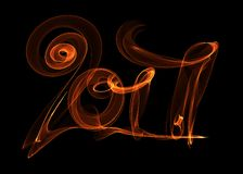Happy new year 2017 isolated numbers lettering written with fire flame or smoke on black background.  Royalty Free Stock Photography