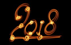 Happy new year 2018 isolated numbers lettering written with fire flame or smoke on black background.  Stock Image
