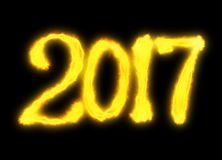 Happy new year 2017 isolated numbers lettering written with fire flame or smoke on black background.  Stock Photo