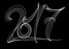 Happy new year 2017 isolated numbers lettering written with white fire flame or smoke on black background.  Stock Photos