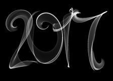 Happy new year 2017 isolated numbers lettering written with white fire flame or smoke on black background.  Stock Photography