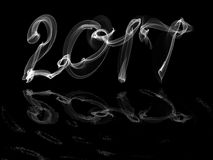 Happy new year 2017 isolated numbers with water reflection written  smoke or fire on black background. Happy new year 2017 isolated numbers with water reflection Royalty Free Stock Photo