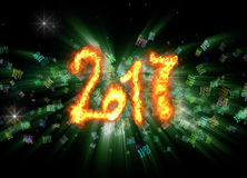 Happy new year 2017 isolated numbers written with fire on bright bokeh background full of flying digits 3d illustration.  Royalty Free Stock Photography