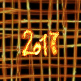 Happy new year 2017 isolated numbers written with fire on bright burning grid bokeh background. Royalty Free Stock Image