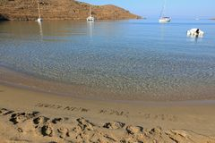 Happy New Year 2019 from Kolona double bay Kythnos island Cyclades Greece. Winter holidays by the sea concept royalty free stock images