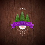 Happy new year label with fir trees. Wooden background. Vector illustration Stock Photos