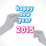 Happy new year 2015 label hold in hand.  Royalty Free Stock Image