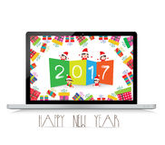Happy new year 2017 with laptop funny kids Stock Photos