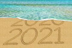 Happy New Year 2021 and leaving year of 2020 concept text on the sea beach