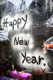 Happy new year letter on glass, focus on wording Stock Photo