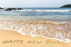 Happy New Year 2017 on the beach. Happy New Year 2017, lettering on the beach