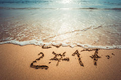Happy New Year 2017. Happy New Year 2017, lettering on the beach. Instagram effect (vintage