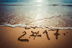 Happy New Year 2017. Happy New Year 2017, lettering on the beach. Instagram effect vintage Stock Photo