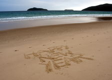 Happy New Year lettering on the beach. Happy new year written on sand at sunset. Happy New Year lettering on the beach. `Happy New Year` drawn on sand on a Royalty Free Stock Photography