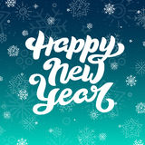 Happy New Year lettering for greeting card. Holiday lettering with white snowflakes on blue sky background. Happy New Year lettering for greeting card. Winter Stock Photos