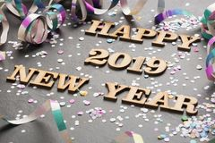 Happy New Year 2019 - Letters on wood and black background stock photos