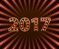 Happy New Year 2017 light bulb retro neon background. Royalty Free Stock Photo