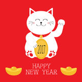 Happy New Year. Lucky white cat sitting and holding golden coin 2017 text. Chinese gold Ingot Japanese Maneki Neco kitten waving h Royalty Free Stock Photography